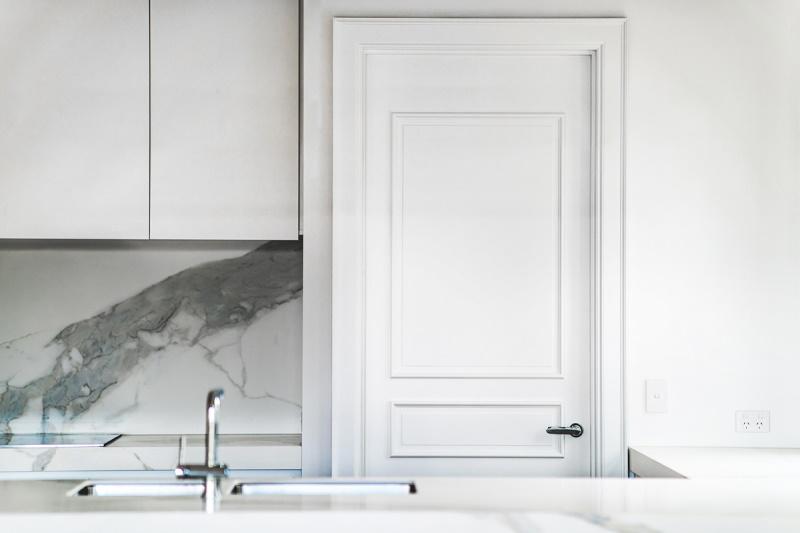 Architraves around a door in a kitchen